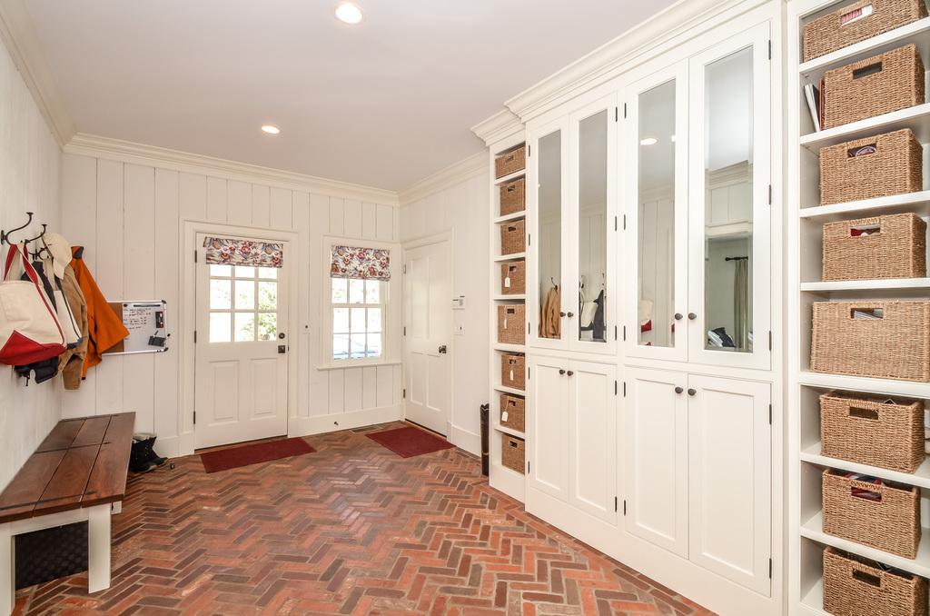 The Mudroom.  My favorite room! Great brick floor.  Tons of storage, and cabinetry to keep what you want out of sight!  Accessible to the 3 car garage and a back entrance for packages and little hockey players!