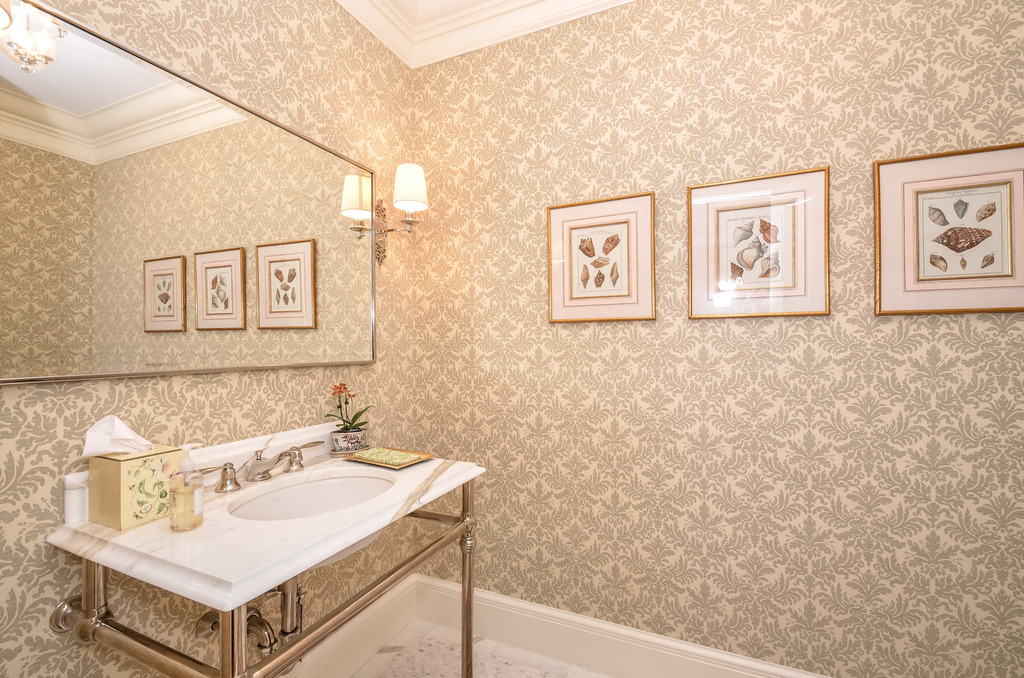 Its rare to take a peek at the powder room... but this one! Oh the wallpaper possibilities!  This paper is a pretty nice choice.
