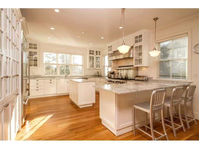 Fabulous and well planned kitchen that open up to the...