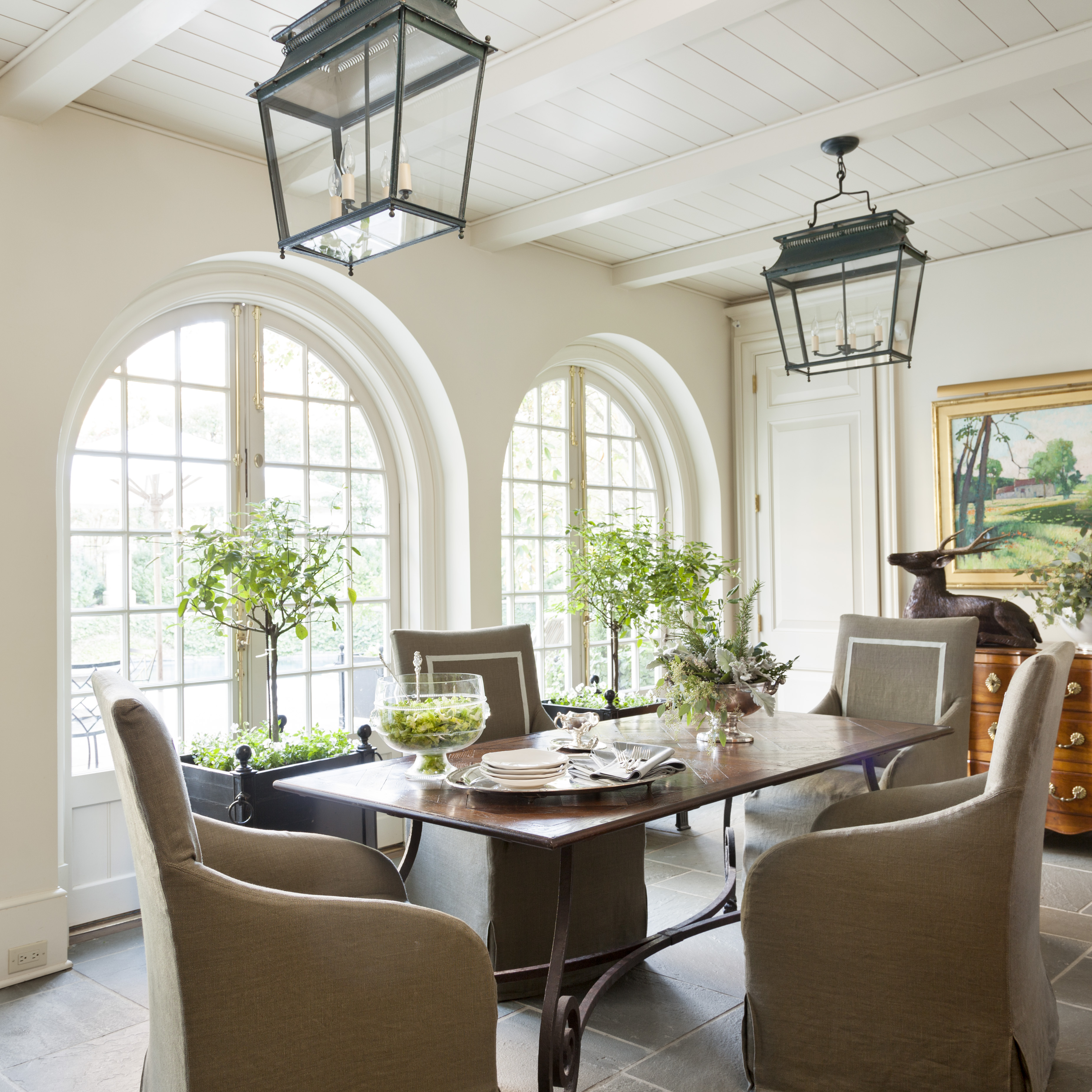 Lanterns, chandeliers, beautiful fabrics and special pieces of furniture all pull together the rooms in their houses.