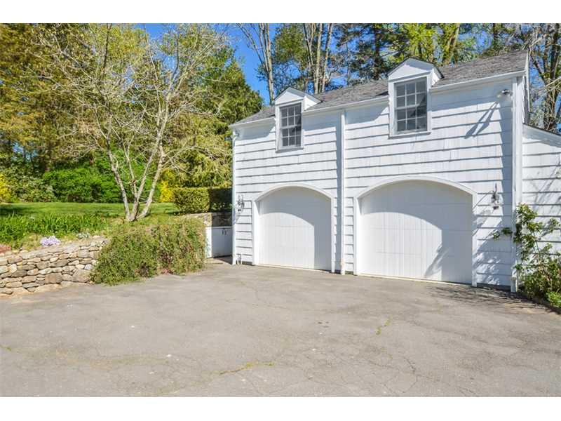 I love the garage doors.  And the stone wall that runs a long the side.