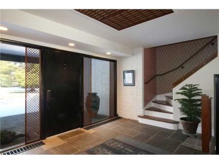 Huge front door and impressive front hall way paves the way to living in a very gracious and chic mid-century modern.