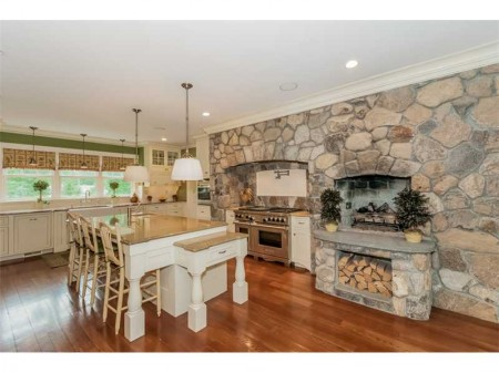Stone fireplace to die for!  A very custom stylish kitchen on Pembroke