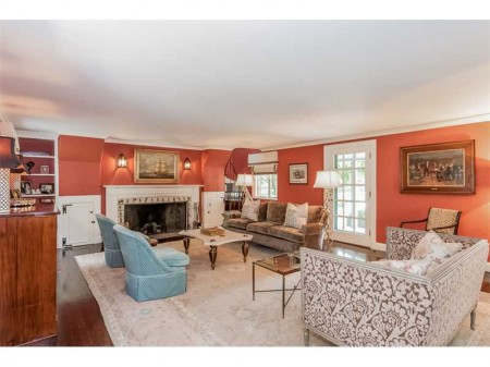 Gorgeous walls.  A large elegant living room is the prefect room for this rich coral color.