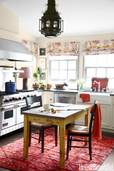 As I sit here dreaming about the Cornue range I hope to own some day, I think in the October 2014 issue of House Beautiful, this kitchen takes it! I am going with the cozy and colorful kitchen!