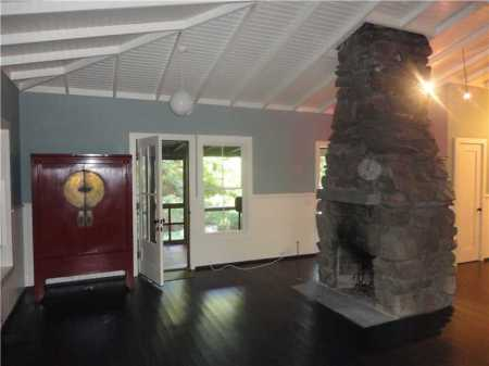 Open Livingroom with large stone fireplace.