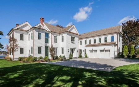 25 Brush Island is situated on a little over one acre with spectacular views of Holly Pond and Long Island Sound.