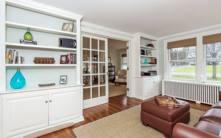 Nice details include built in bookshelves, and a screened in porch.