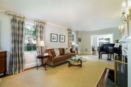 Lovely living room with lots of light and space for a grand piano. A very pretty room.