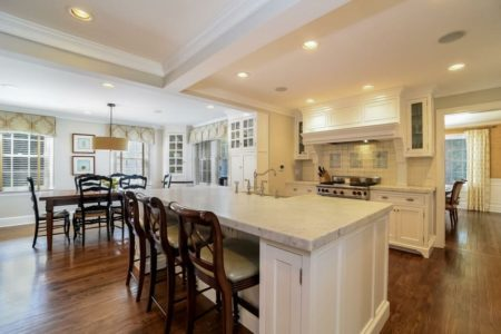 A classically designed kitchen that has a lot of storage and space for entertaining and living with all those kids!