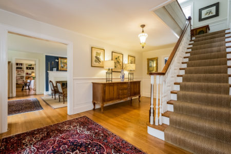 You are not going to find a gracious front hall like this. The staircase says it all.